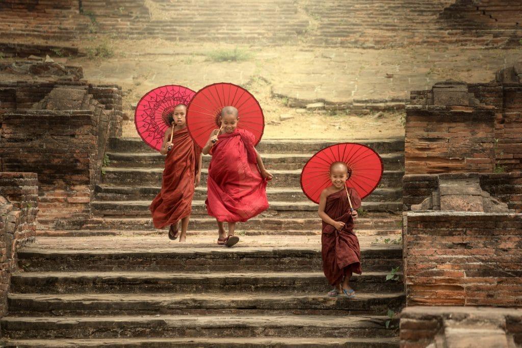 Novice monks walking on pagoda mandalay,myanmar