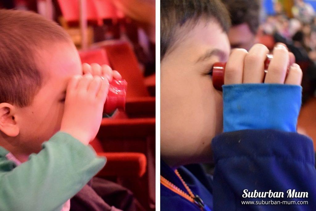 boys with theatre binoculars