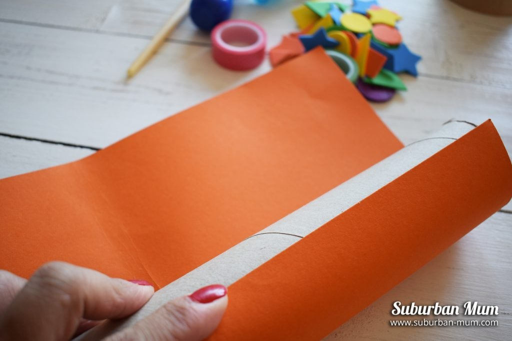 Wrapping colour card around empty kitchen roll tube