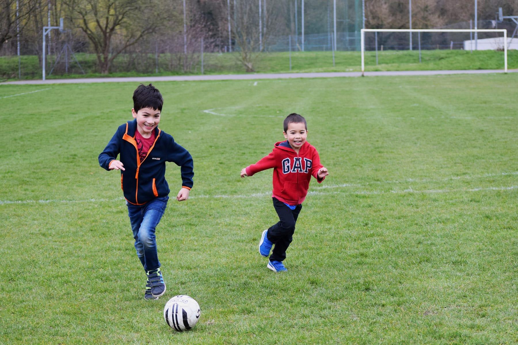 boys-playing-football-ft