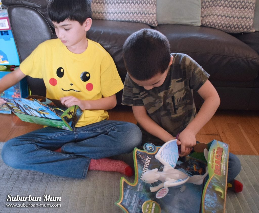 Boys opening How to Train Your Dragon toys