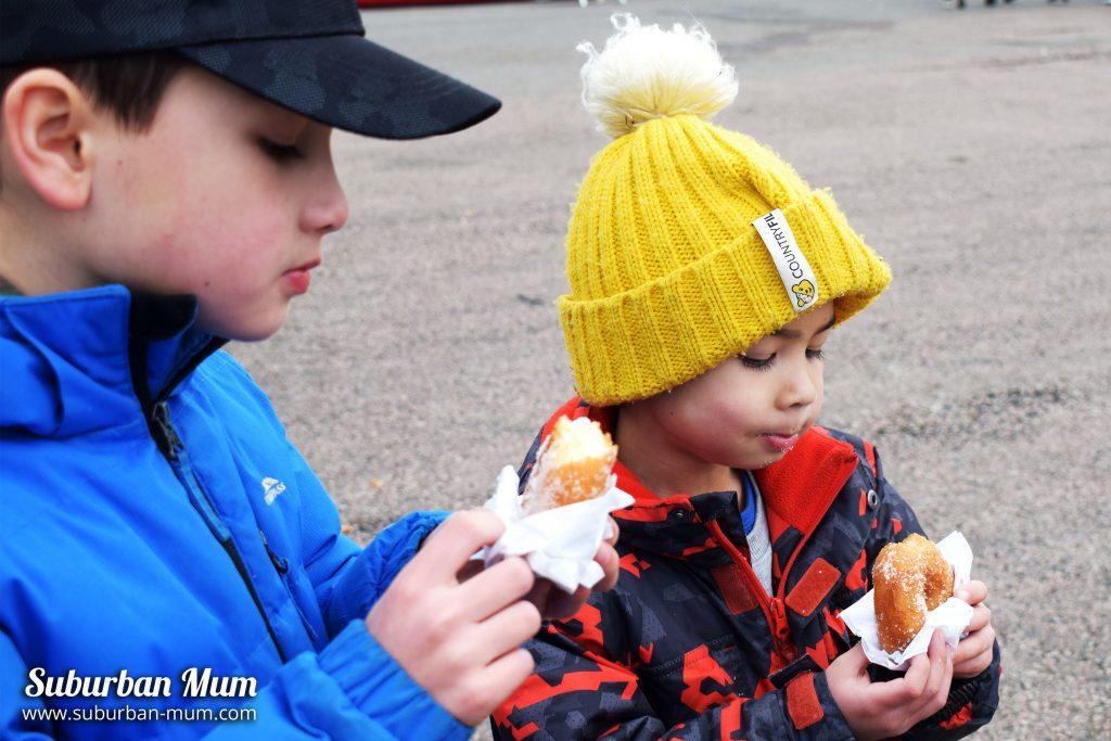 Boys eating donuts at Stuntfest, Santa Pod Raceway