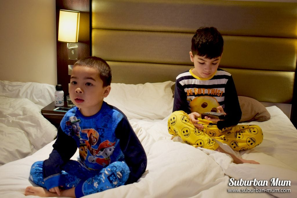 Boys watching tv in bed with The Pyjama Factory pyjamas