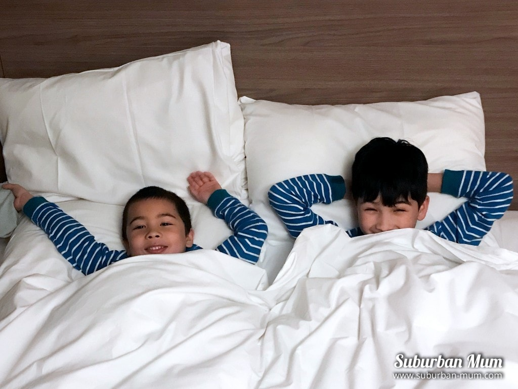 boys-double-bed-hotel-room
