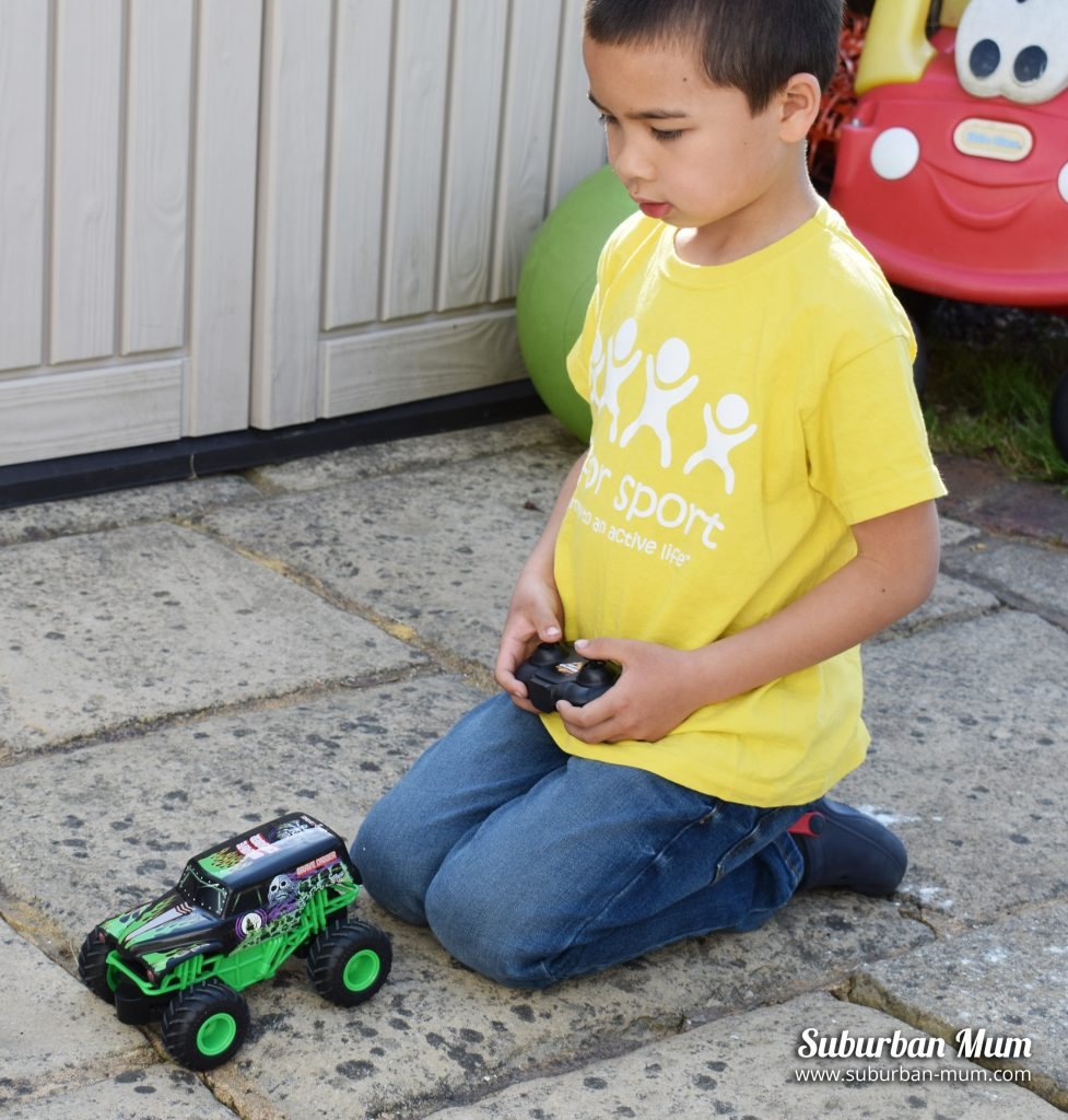 M playing with the Monster Jam Grave Digger remote control car