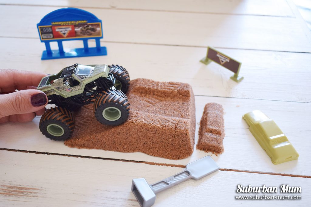 Monster Jam Monster Dirt Deluxe set with monster truck going up a rampe and kinetic sand