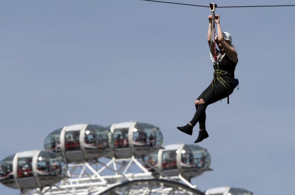 Zip London - Lady on a zip wire across London