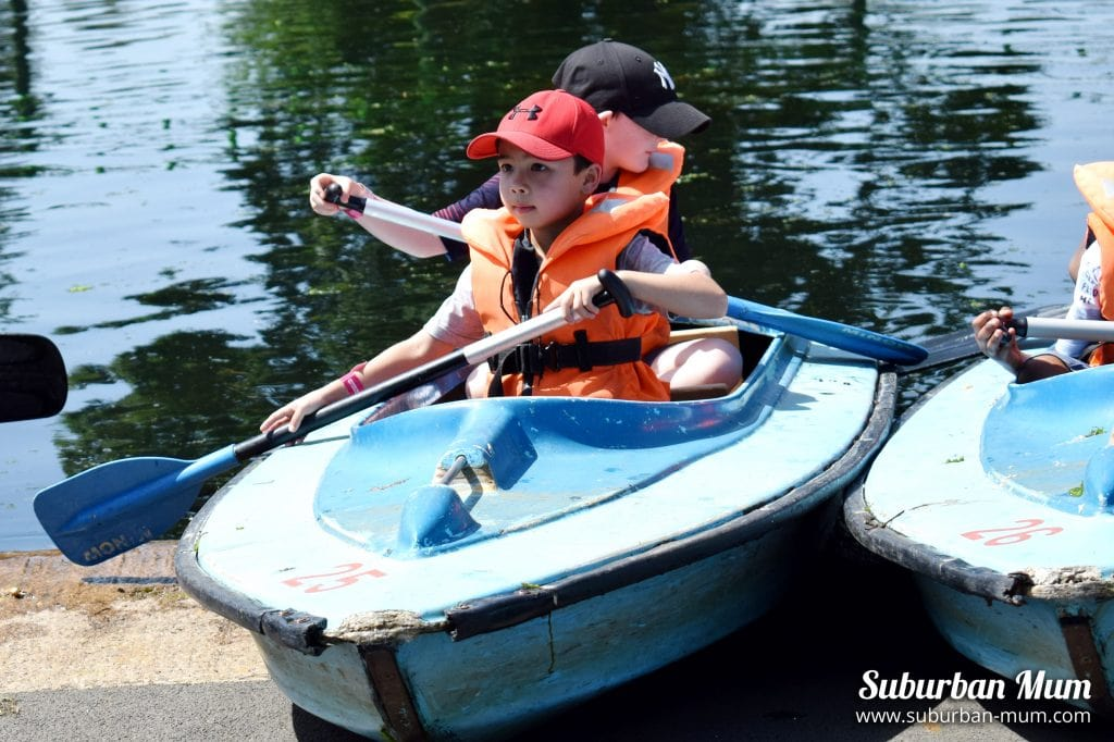 Child rowing in a canoe at Wicksteed Park