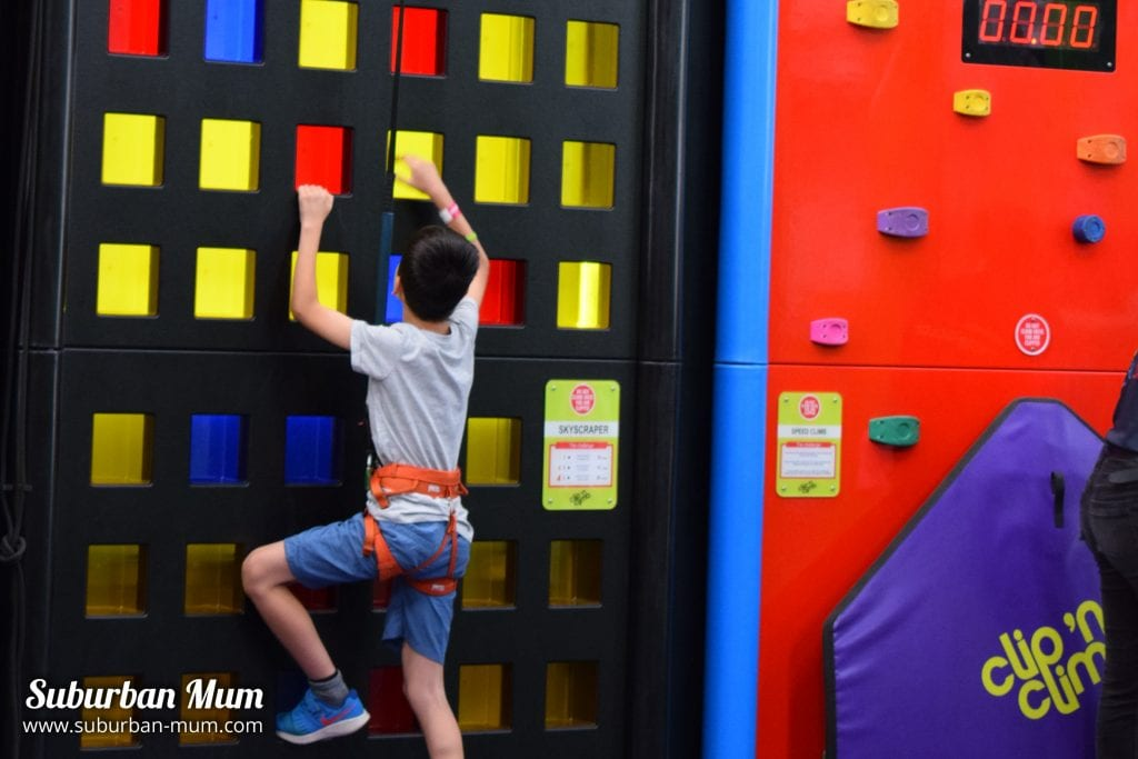 Climbing onto a wall at Clip 'n Climb Wicksteed Park