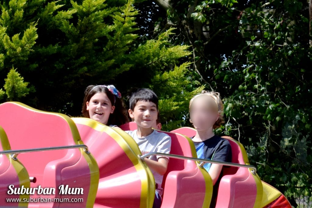 Children riding the Clown Coaster at Wicksteed Park