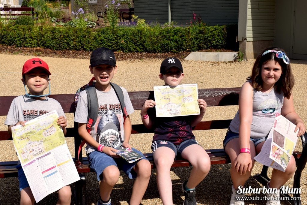 Kids on a bench waiting to start their day at Wicksteed Park