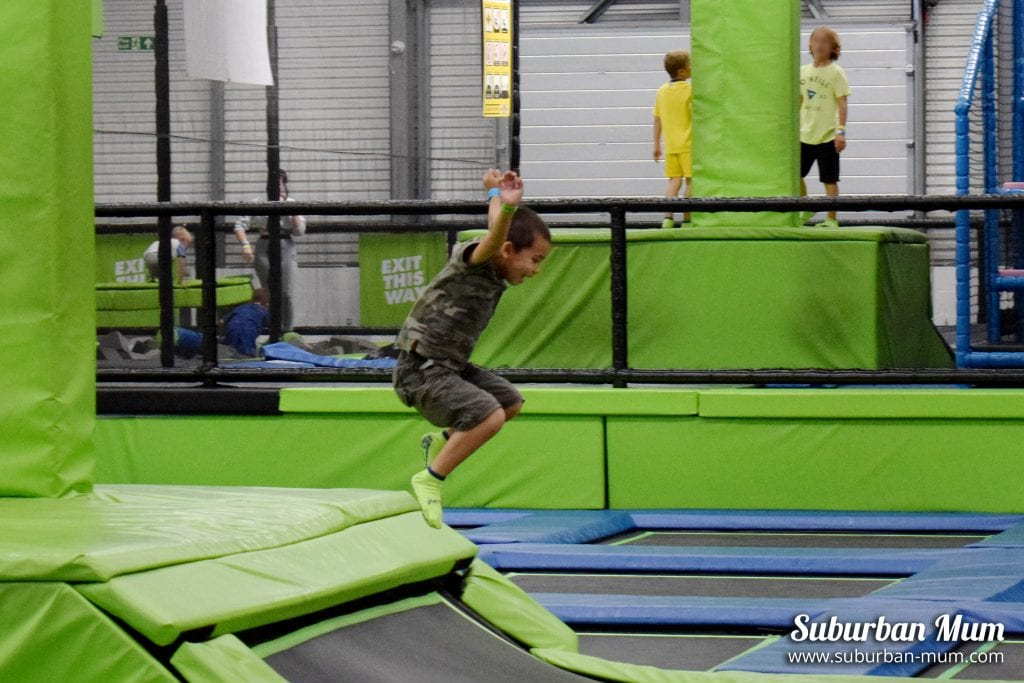 M, mid-air jumping off a trampoline