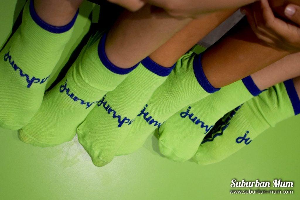 Children wearing green Jump In Trampoline socks