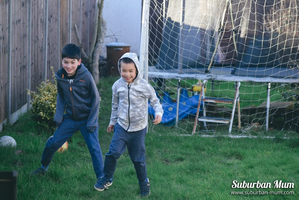 boys-playing-football-garden