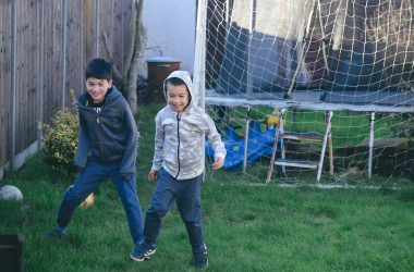 boys-playing-football-garden-ft