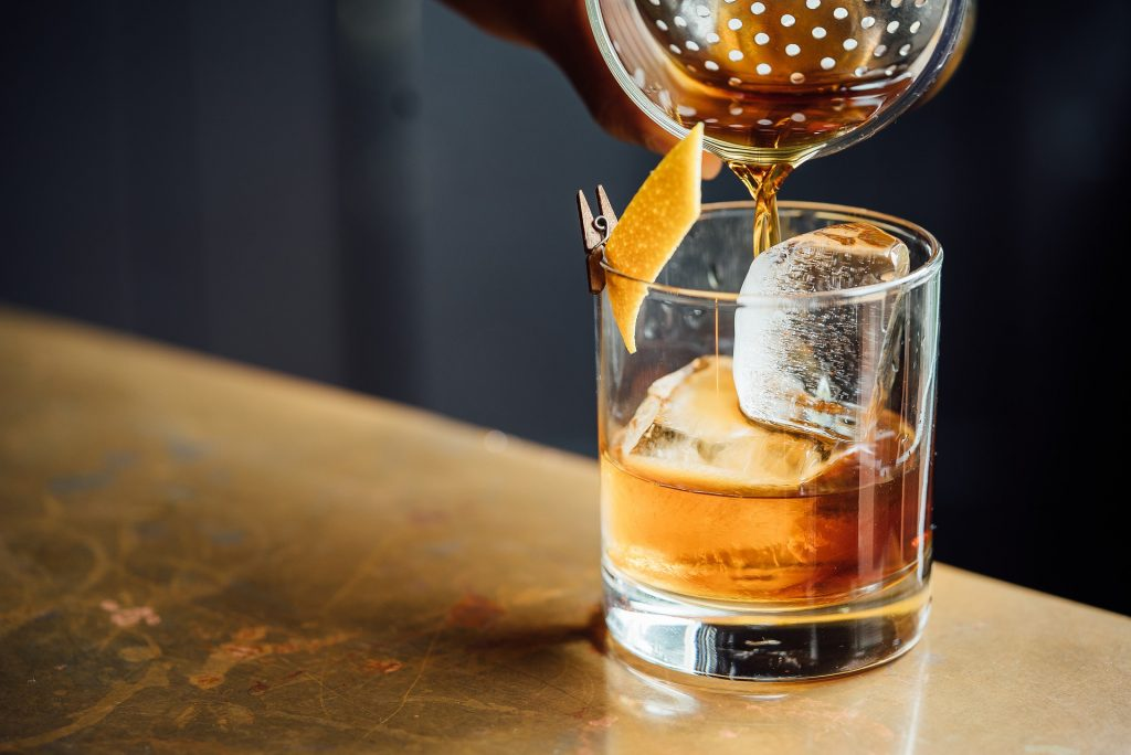 Whisky pouring from a cocktail shaker