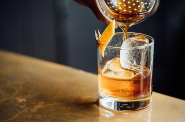 whisky-pouring-from-a-cocktail-shaker